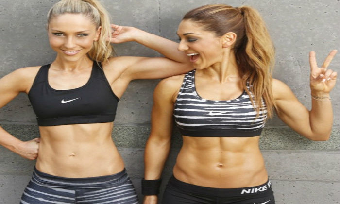 Using your Metabolics to get abs with two females in workout clothes