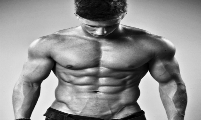 Front view of ripped abs guy looking down