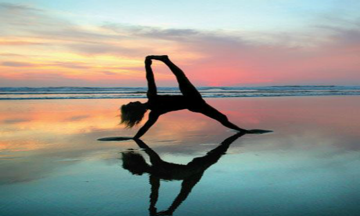 better health with yoga on the beach at sunrise