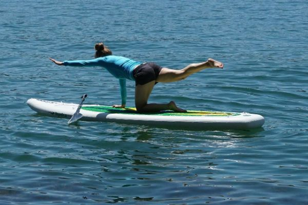 Doing yoga on a paddle board