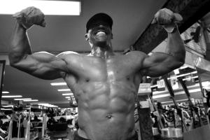 bodybuilder posing and how testosterone helps men
