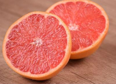 Sliced open red grapefruit.